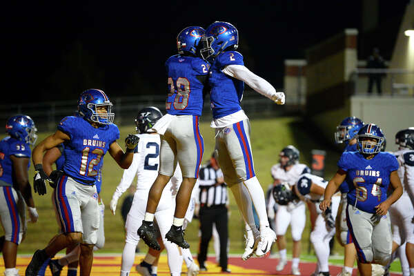 West Brook's Joey Pierre celebrates a touchdown with teammate Deonte Simpson against Kingwood in a bi-district playoff game at BISD Memorial Stadium on Friday night. Photo taken Friday 11/16/18 Ryan Pelham/The Enterprise
