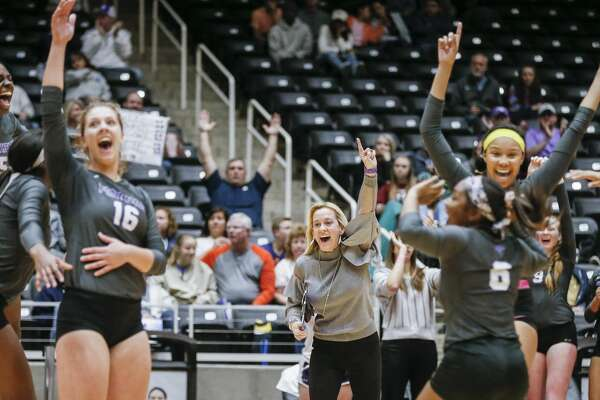 Ridge Point head coach Lori McLaughlin, center, celebrates with her team a point against Plano West during a Class 6A State Semifinal volleyball game at the Curtis Culwell Center in Garland, Texas, Friday, November 16, 2018. Ridge Point won the match in four sets to advance to the State Finals. (Brandon Wade/Contributor)