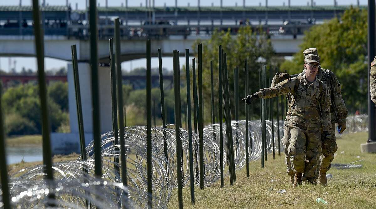 The U.S. military installs concertina wire along the banks of the Rio Grande on Friday, Nov. 16, 2018 as they reinforce the border and ports of entry in Laredo, Texas.