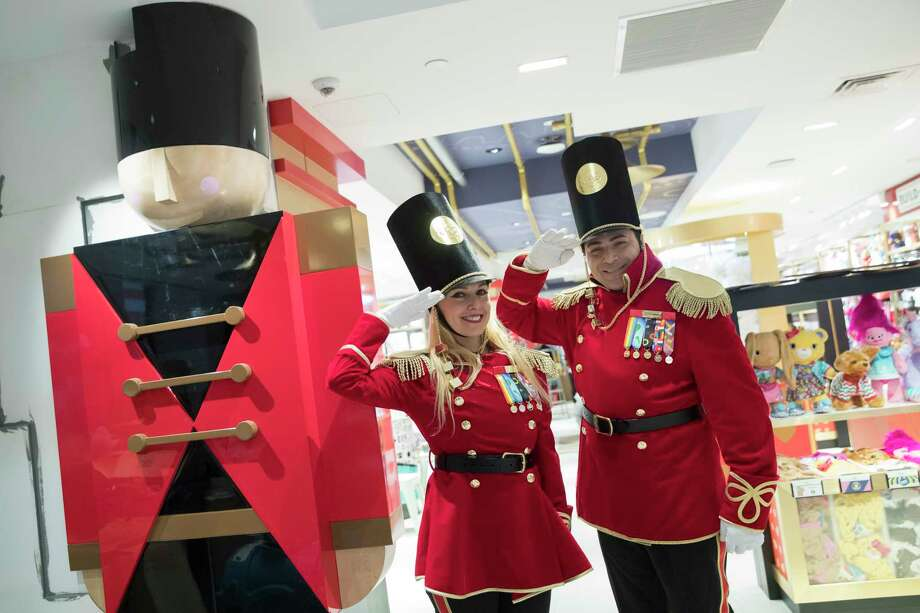 """In this Tuesday, Nov. 13, 2018 photo, FAO Schwarz toy soldiers dressed in uniforms designed by model Gigi Hadid pose for a photo during a media preview of the new FAO Schwarz store at Rockefeller Center in New York. Three years after it closed its beloved toy store on Fifth Avenue, FAO Schwarz is making a return to New York opening on Friday, Nov. 16, 2018. The new version will be smaller, but will have familiar attractions, including a musical clock tower and the giant piano keyboard mat on which Tom Hanks danced in the film """"Big."""" (AP Photo/Mary Altaffer) Photo: Mary Altaffer / Copyright 2018 The Associated Press. All rights reserved."""