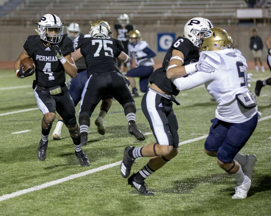 "FILE: In this Friday, November 16, 2018, photo Odessa Permian's Justin Hammond (4) runs the ball down the field Friday night at Ratliff Stadium. Part of late billionaire H. Ross Perot's legacy is a clear-cut rule about Texas high school sports: If a student can't pass class, they can't play. The law, with its catchy ""No Pass, No Play"" nickname has been in place since 1984. Photo: Jacy Lewis/191 News"