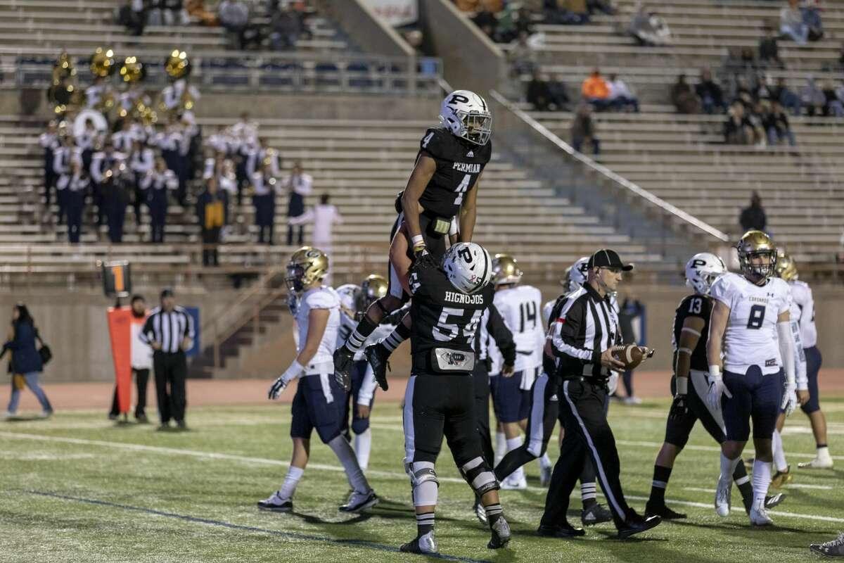 Justin Hammond (4) and Jon Hignojos (54) celebrate after a touchdown Friday night. Permian vs El Paso Coronado. 11/16/2018 Jacy Lewis/191 News