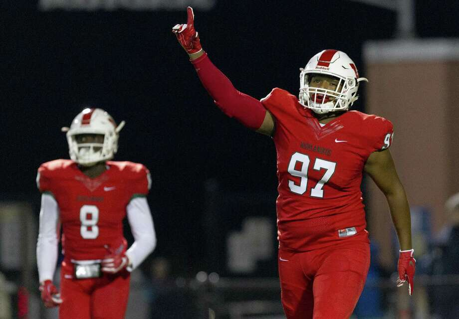 The Woodlands defensive lineman Armani Lowery (97) reacts after the Highlander defense forced Aldine Davis into a three-and-out on its first drive during the first quarter of a Region II-6A (Div. I) bi-district playoff football game at Woodforest Bank Stadium, Friday, Nov. 16, 2018, in Shenandoah. Photo: Jason Fochtman, Houston Chronicle / Staff Photographer / © 2018 Houston Chronicle