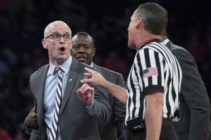 UConn head coach Dan Hurley, left, argues with the referee during the final game in the 2K Empire Classic, on Friday at Madison Square Garden in New York.