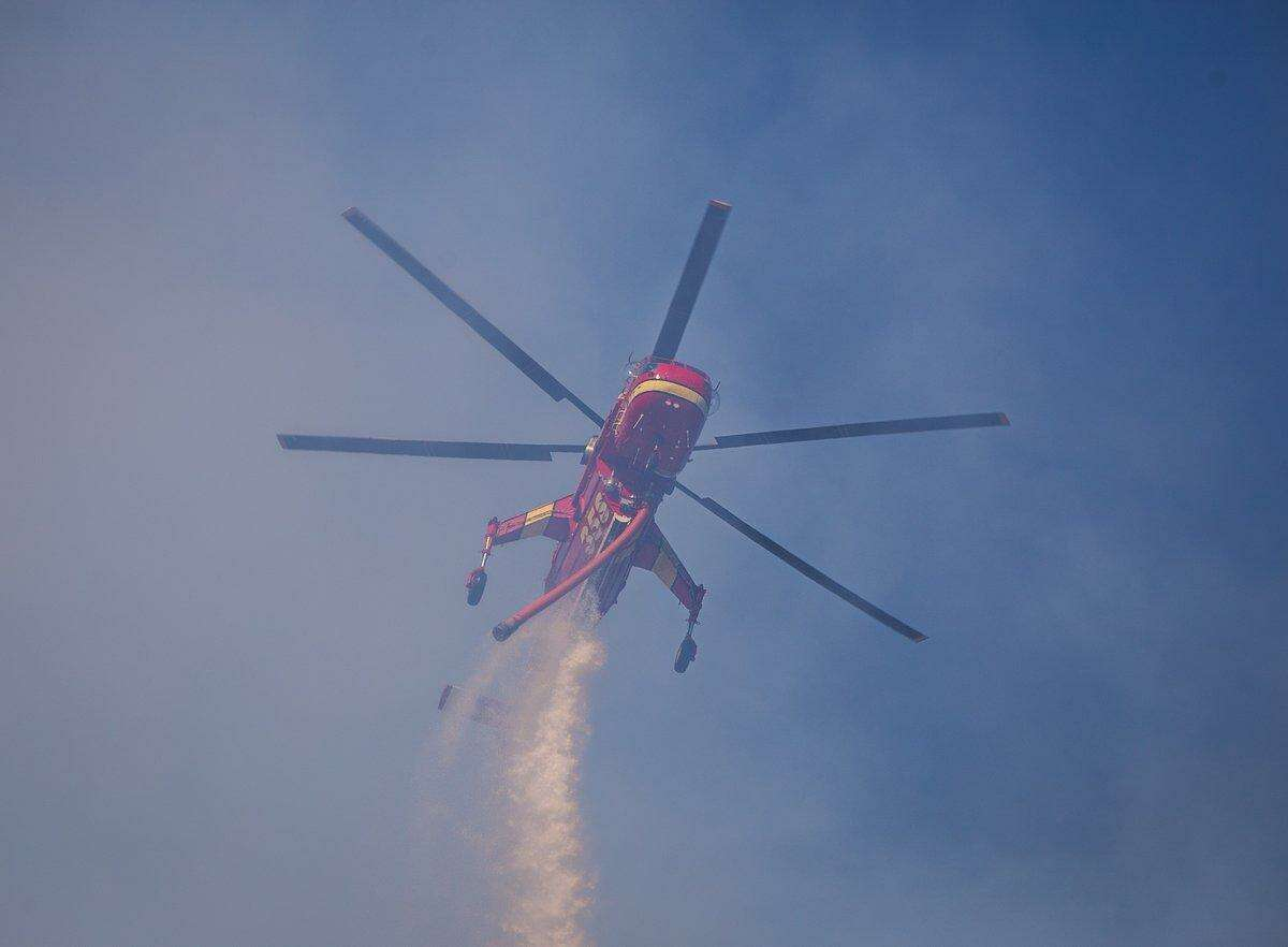 At its peak, the blaze stretched over 25 acres to burn east of Middleton Drive.