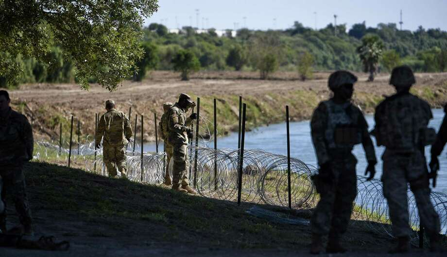 The U.S. military installs concertina wire along the banks of the Rio Grande on Friday, Nov. 16, 2018 as they reinforce the border and ports of entry in Laredo, Texas. Photo: Danny Zaragoza, Staff Photographer / Laredo Morning Times / Laredo Morning Times