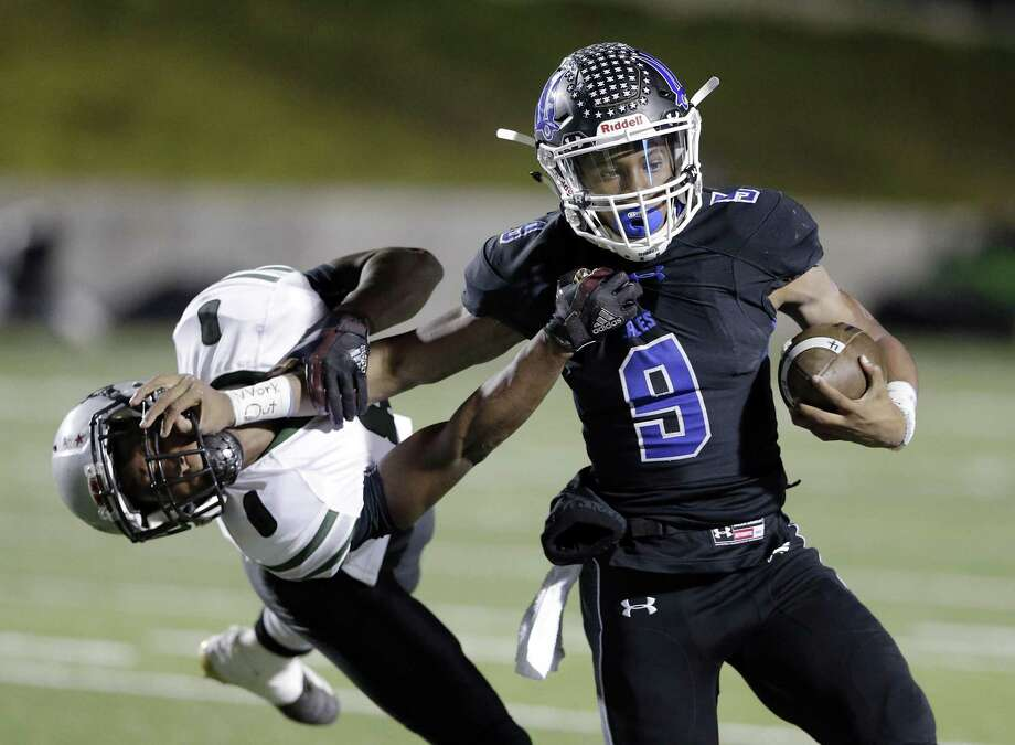 New Caney quarterback Zion Childress (9) stiff arms Ft. Bend Hightower's Derrck Sasser (8) on Friday. Photo: Michael Wyke, Houston Chronicle / Contributor / © 2018 Houston Chronicle