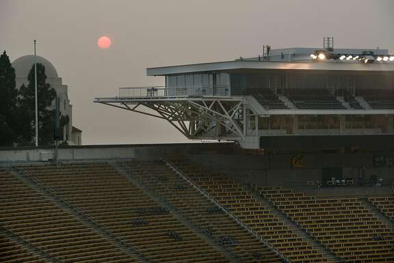 """A smokey haze hangs over Memorial Stadium after it was announced that the """"Big Game"""" versus Stanford University over the weekend is canceled due to poor air quality, in Berkeley, California, on Friday, November 16, 2018."""