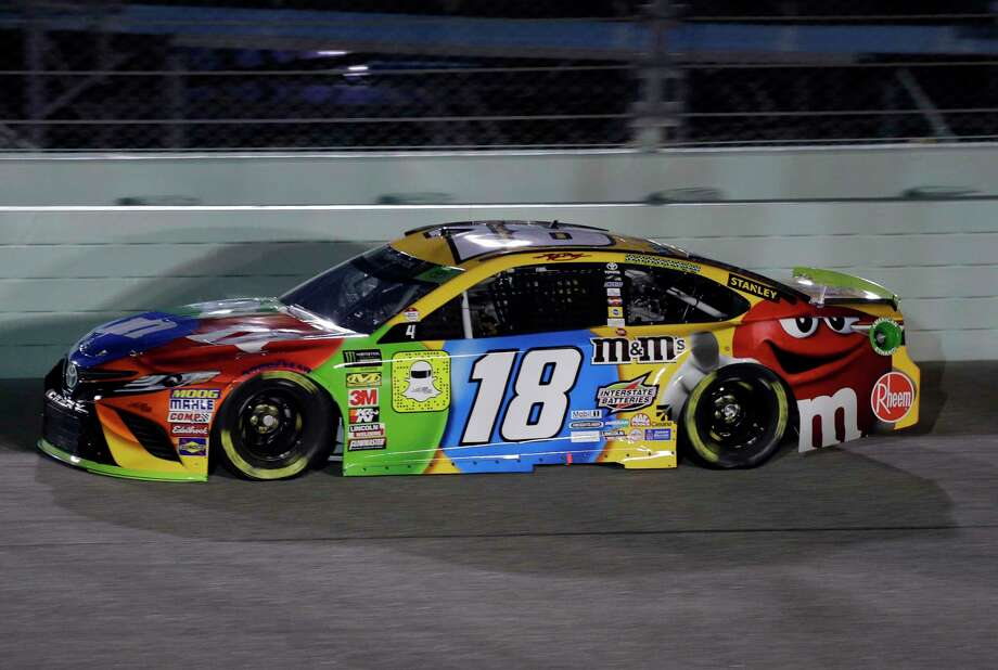 Kyle Busch (18) drives on the track during qualifying for the NASCAR Cup Series auto race at the Homestead-Miami Speedway, Friday, Nov. 16, 2018, in Homestead, Fla. (AP Photo/Terry Renna) Photo: Terry Renna / Copyright 2018 The Associated Press. All rights reserved.