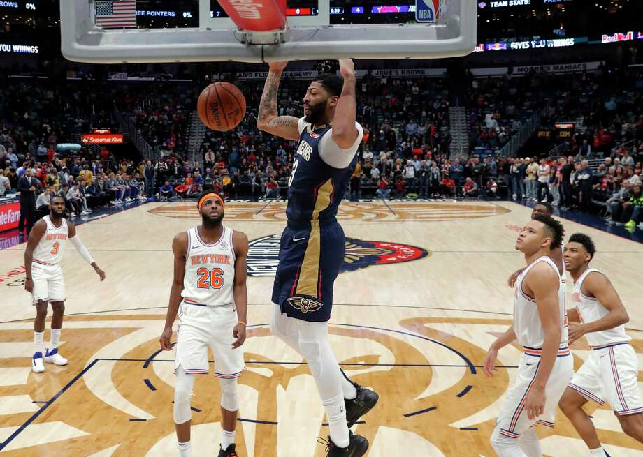 7afd6e09d82b New Orleans Pelicans forward Anthony Davis (23) slam dunks in front of New  York
