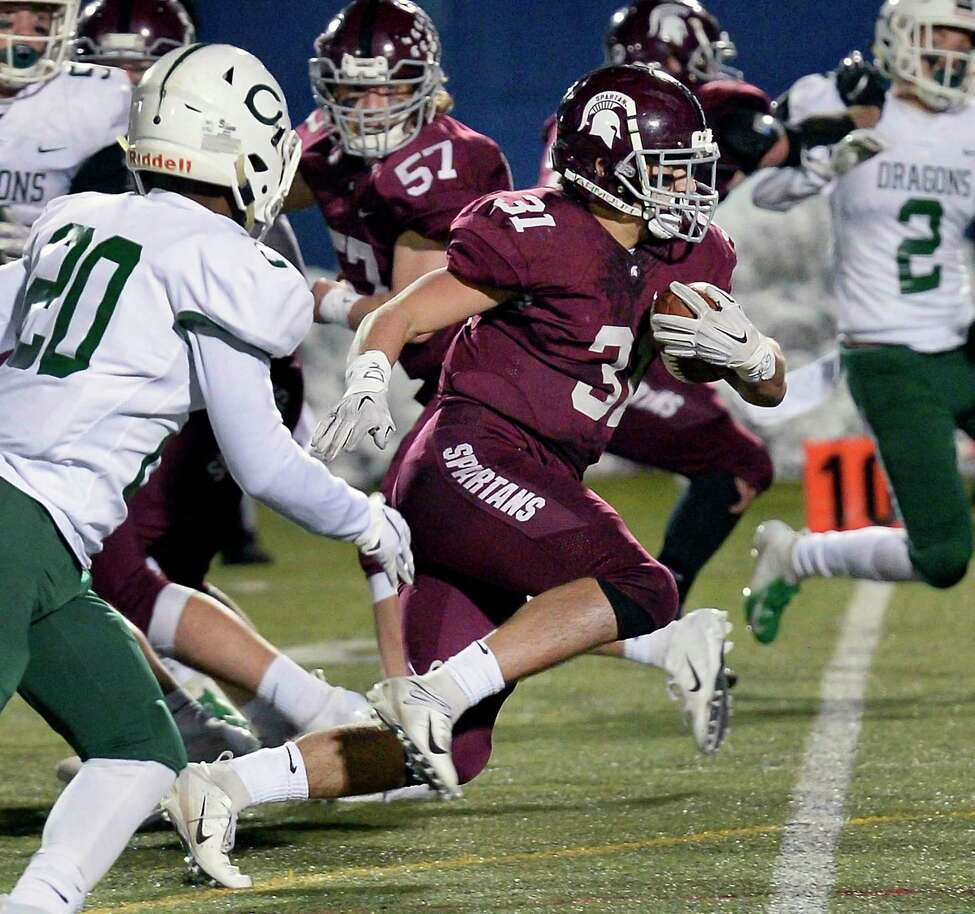 Burnt Hills' #31 Vincent Daviero breaks through the Cornwall line to score a touchdown during their Class A semifinal game Friday Nov. 16, 2018 in Middletown, NY. (John Carl D'Annibale/Times Union)