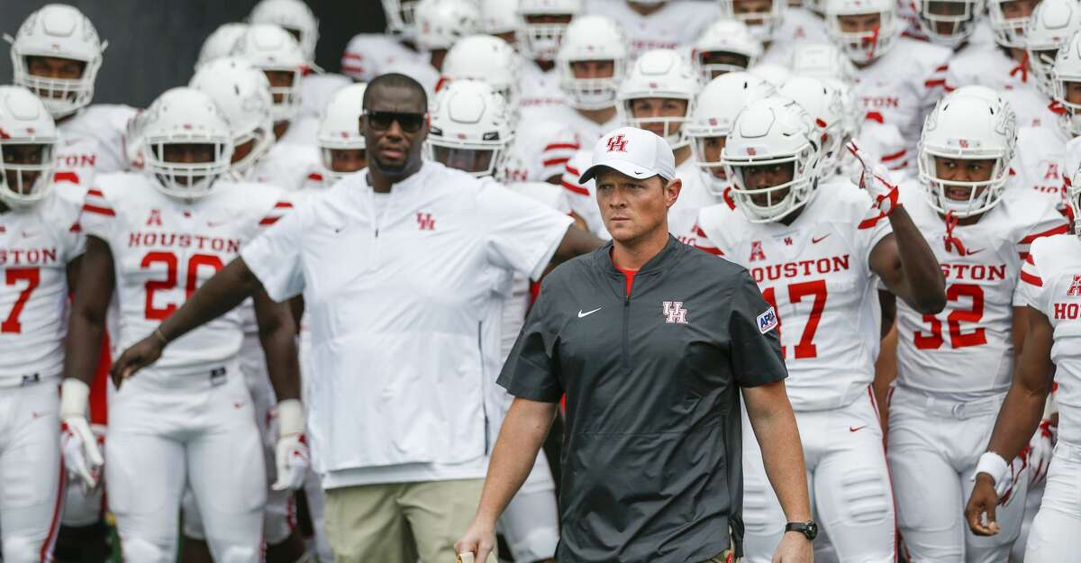 Houston head coach Major Applewhite leads his team out of the tunnel for an NCAA football game, in Houston.
