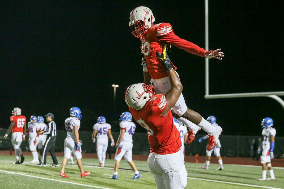 Judson's De'Anthony Lewis is lifted into the air by De'Marvin Leal after scoring on a 31-yard touchdown run during the second half of their Class 6A Division I first round playoff game with Buda Hays at Rutledge Stadium on Friday, Nov. 16, 2018. Judson beat Hays 49-14. Photo: Marvin Pfeiffer, Staff Photographer / Express-News 2018
