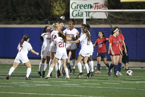 The Stanford women's soccer team celebrates a 4-1 victory over Mississippi in the NCAA tournament in Salinas on Friday night.