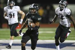 Knight running back Robert Collins speeds down the left sideline for an early touchdown and lead for his team as Steele hosts Bowie in first round playoff action at Lehnhoff Stadium on November 16, 2018.