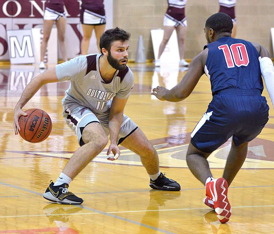 TAMIU lost in the final seconds 52-51 at Rogers State on Saturday falling into a tie for the final Heartland Conference tournament spot with two games to play. Point guard Danny Spinuzza finished with seven points, 10 rebounds and three assists. Photo: Cuate Santos /Laredo Morning Times File / Laredo Morning Times