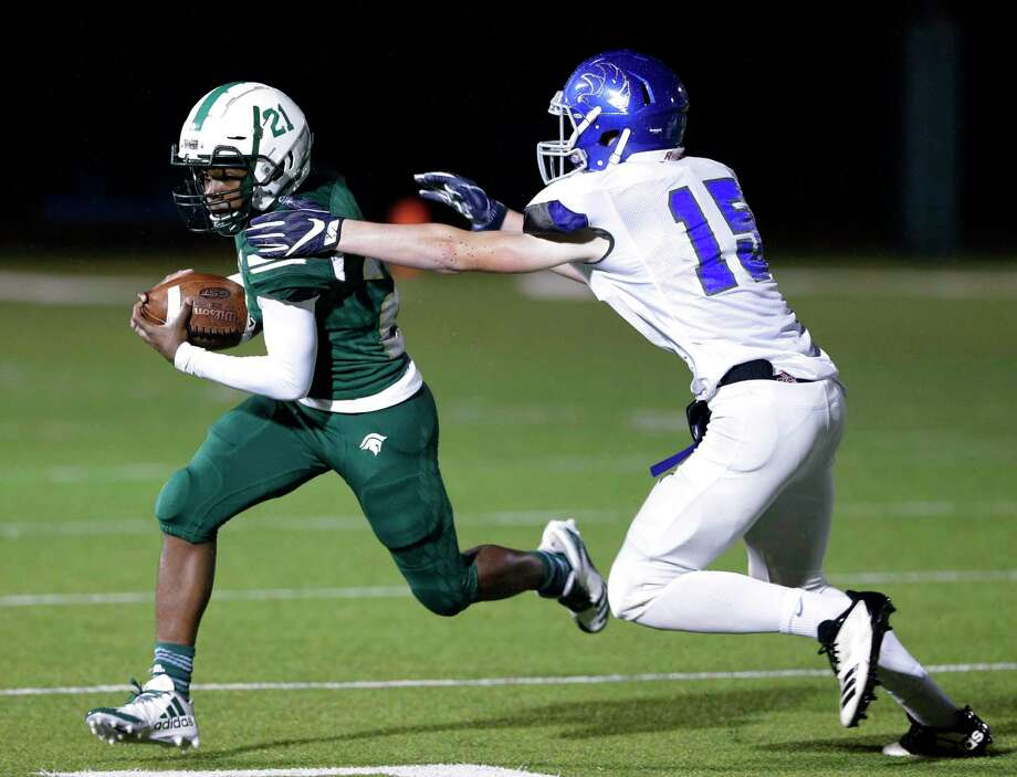 The Woodlands Christian's Dane Jackson (21) breaks the tackle attempt by Frassati Catholic's Joey Abrams (15) during the first half of their game at TWCA Friday, Oct. 19, 2018 in The Woodlands, TX. Photo: Michael Wyke, Houston Chronicle / Contributor / © 2018 Houston Chronicle