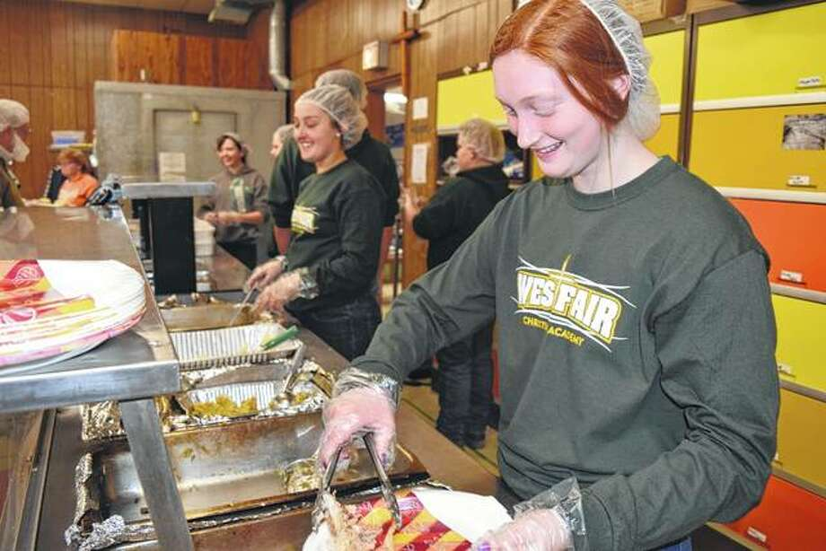 Westfair Christian Academy student Addie Ford, 15, of Winchester serves turkey at The Salvation Army's Community Thanksgiving Dinner on Friday. Photo: Nick Draper | Journal-Courier