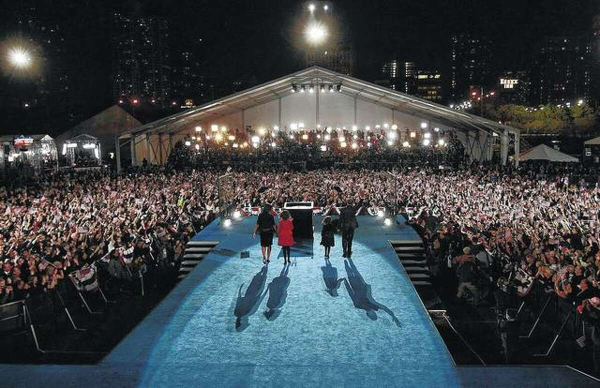 Barack Obama, his wife, Michelle, and daughters Malia and Sasha take the stage to deliver his victory speech at his 2008 election night party in Grant Park in Chicago.