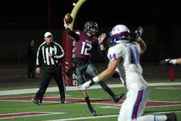 Pearland quarterback J.D. Head (12) drops back to pass against Dickinson Friday at The Rig.