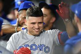 BALTIMORE, MD - SEPTEMBER 17: Aledmys Diaz #1 of the Toronto Blue Jays celebrates a home run during a baseball game against the Baltimore Orioles at Oriole Park at Camden Yards on September 17, 2018 in Baltimore, Maryland. (Photo by Mitchell Layton/Getty Images)