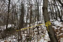 Police tape blocks access to the scene of a suspicious death in Cohoes Saturday.