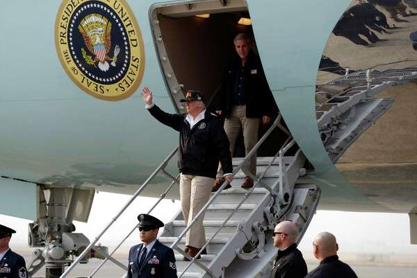 President Donald Trump waves as he arrives on Air Force One at Beale Air Force Base for a visit to areas impacted by the wildfires, Saturday, Nov. 17, 2018, at Beale Air Force Base, Calif. He is followed by House Majority Leader Kevin McCarthy of Calif.