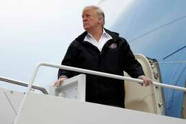 President Donald Trump boards Air Force One for a trip to visit areas impacted by the California wildfires, Saturday, Nov. 17, 2018, at Andrews Air Force Base, Md.