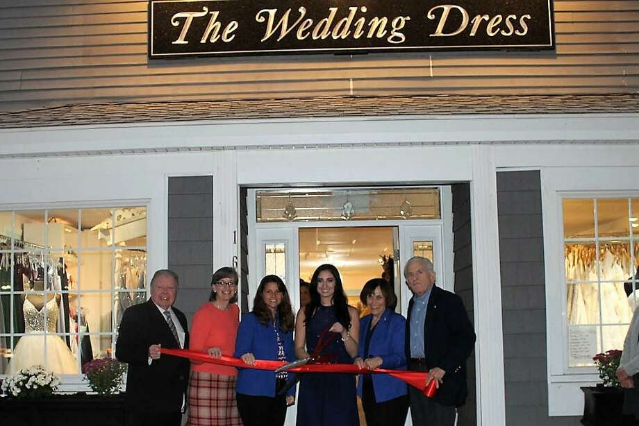 The Wedding Dress had a grand reopening at 162 Main St., Portland, Nov. 8. From left are Middlesex County Chamber of Commerce Chairman Jay Polke, Portland Division Chair Mary Dickerson, state Rep. Christie Carpino, Wedding Dress Owner Abbie Paklos, Portland First Selectwoman Susan Bransfield and Chamber President Larry McHugh. Photo: Contributed Photo