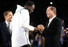 Golden State Warriors' Draymond Green receives his 2018 NBA Championship ring from owner Joe Lacob during a ceremony before Opening Night game against Oklahoma City Thunder at Oracle Arena in Oakland, Calif. on Tuesday, October 16, 2018.