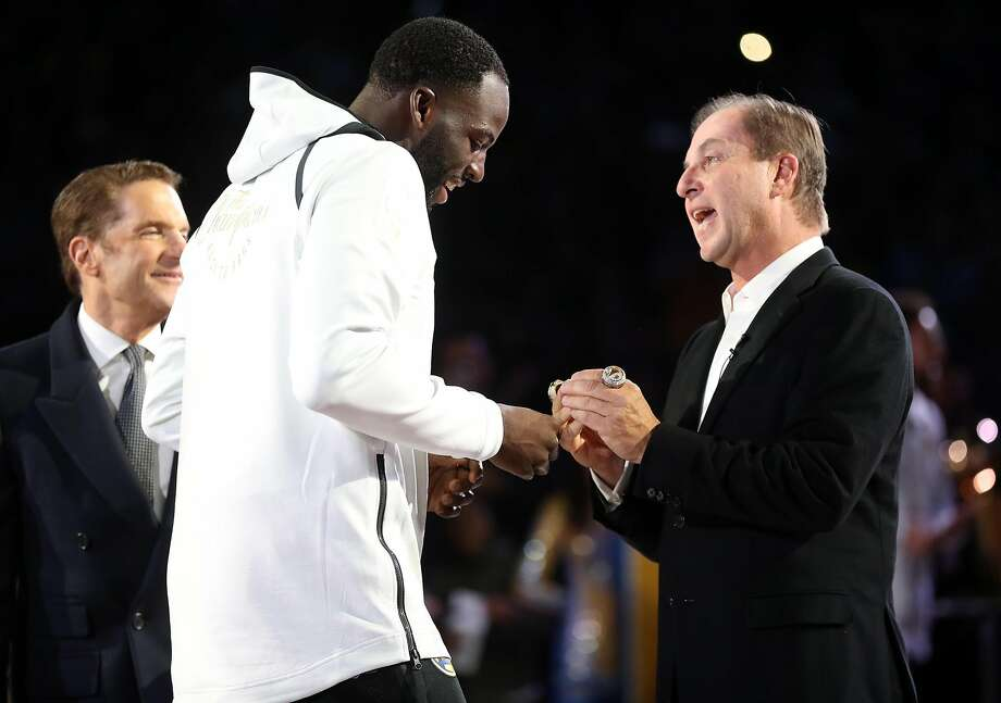 Golden State Warriors' Draymond Green receives his 2018 NBA Championship ring from owner Joe Lacob during a ceremony before Opening Night game against Oklahoma City Thunder at Oracle Arena in Oakland, Calif. on Tuesday, October 16, 2018. Photo: Scott Strazzante, The Chronicle