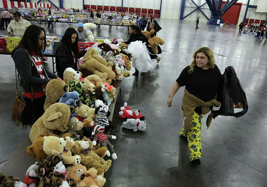 George R. Brown Center will again be the gathering point of all the toys collected from the businesses that have partnered with Luethold. Photo: James Nielsen, Staff / Houston Chronicle / © 2016  Houston Chronicle