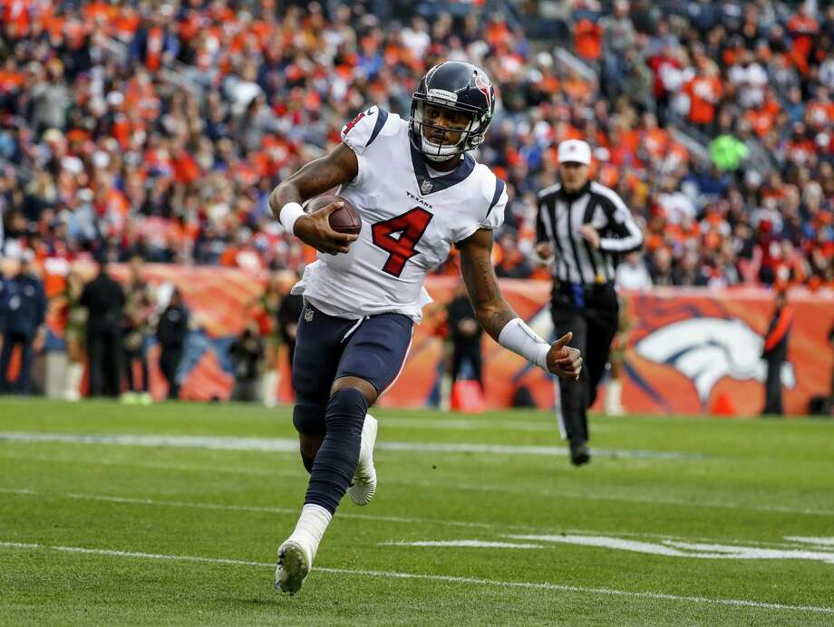 Houston Texans quarterback Deshaun Watson runs against the Denver Broncos during the first half of an NFL football game, Sunday, Nov. 4, 2018, in Denver. (AP Photo/Jack Dempsey) Photo: Jack Dempsey, FRE / Associated Press / Copyright 2018 The Associated Press. All rights reserved
