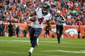 Houston Texans quarterback Deshaun Watson runs against the Denver Broncos during the first half of an NFL football game, Sunday, Nov. 4, 2018, in Denver. (AP Photo/Jack Dempsey)