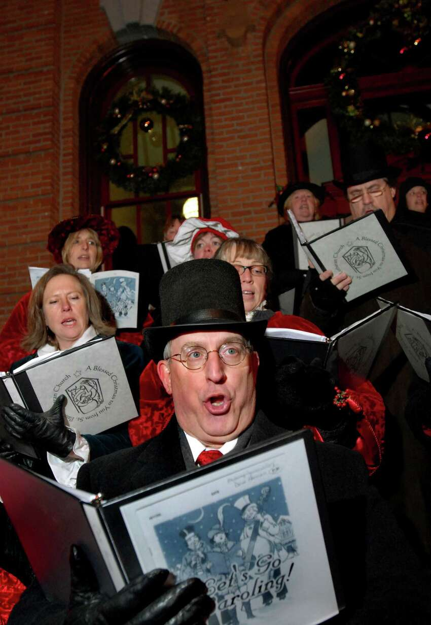 CINDY SCHULTZ/TIMES UNION -- Dave Herman, center, sings Christmas carols with the St. Paul Lutheran Church Victorian Singers during the 22nd Annual Victorian Streetwalk on Thursday, Dec. 4, 2008, in front of City Hall in Saratoga Springs, N.Y.