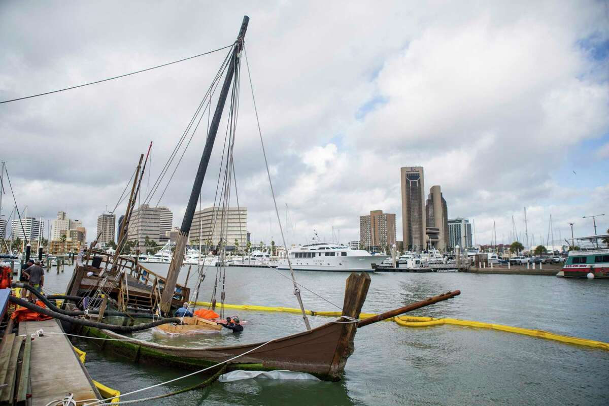 In this Oct. 4, 2017, file photo photo, crews prepare the La Nina before raising it from the bottom of the bay at Lawrence Street T-head in Corpus Christi, Texas. The replica Columbus ship sank when Hurricane Harvey struck Corpus Christi in late August 2017. (Casey Jackson /Corpus Christi Caller-Times via AP, File)