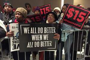Hundreds of demonstrators bused up from the outer boroughs of New York City led the large Fight for $15 protest to raise the minimum wage prior in the Empire State Plaza concourse Wednesday prior to Gov. Andrew Cuomo's State of the State address. (Paul Grondahl / Times Union)