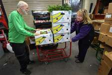 Trader Joe's employee J.D. Smith helps Food Rescue US volunteer Lyn DeTroy as she picks up food from Trader Joe's in Westport Thursday, November 15, 2018, for delivery to the Family and Children's Agency in Norwalk, Conn. Food Rescue US, transfers usable food from grocers, restaurants, catering events, to food insecure families throughout the U.S.