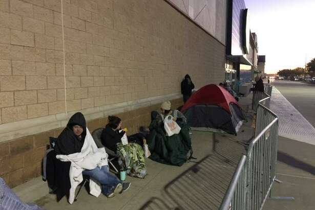 Shoppers line up early to get the best Black Friday deals at stores in the Katy area in 2017.