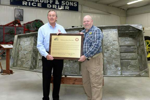 Katy Mayor Chuck Brawner accepts a plaque from Bass Pro Shops (Katy) Community Coordinator Andy Wohlgemuth that accompanies a Hurricane Harvey rescue boat donated to The Johnny Nelson Katy Heritage Museum on Nov. 15.