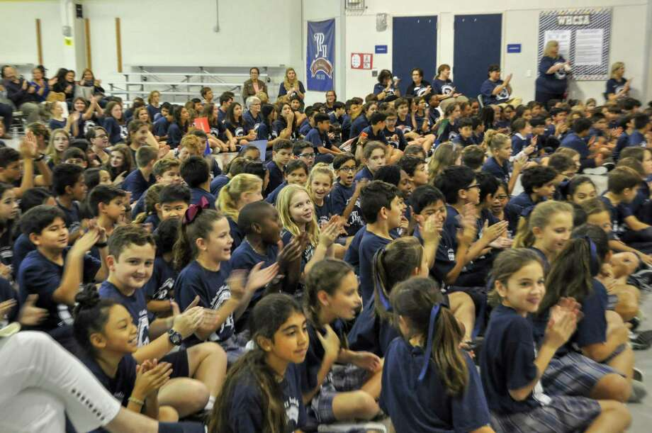 St. John Paul II Catholic School students recently celebrated the school receiving the National Blue Ribbon award from the Department of Education. Photo: Courtesy Photo