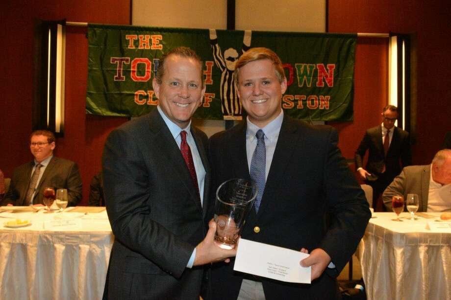 Stratford senior defensive lineman Sam Habel won the Touchdown Club of Houston's 20th annual Scholar-Athlete Award Nov. 14. Presenting the award is Houston Texans president Jamey Rootes.