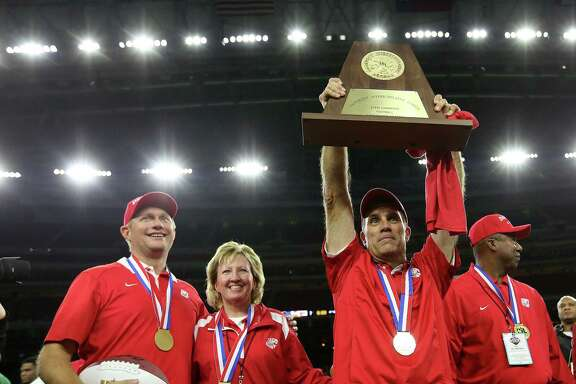 Katy head football coach Gary Joseph holds up the championship trophy after their 6A Division II championship football game win over Austin Lake Travis at NRG Stadium on Saturday, Dec. 19, 2015, in Houston. Katy won the title 34-7. ( Elizabeth Conley / Houston Chronicle )