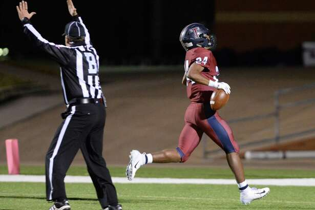 R.J. Smith (24) of Tompkins scores a touchdown in the third quarter of a Class 6A Div. II Reg. III bi-district playoff game between the Tompkins Falcons and the Elkins Knights on Friday, November 16, 2018 at Rhodes Stadium, Katy, TX.