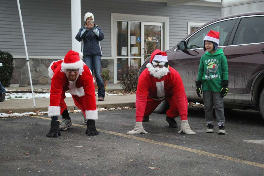 The Sebewaing Spirit of Christmas Festival kicked off this morning with a nice Santa Run through town, followed by the entertaining Christmas parade. Photo: Seth Stapleton/Huron Daily Tribune