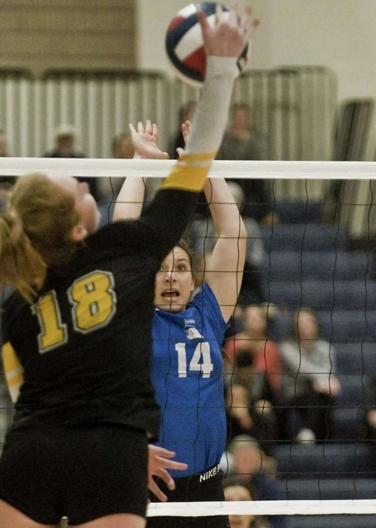Darien High School's Cristina Escajadillo tries to block a shot in the Class LL volleyball championship game against Amity Regional High School, played at East Haven High School. Saturday, Nov. 17, 2018