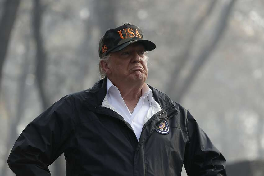 President Donald Trump visits a neighborhood impacted by the wildfires, on Nov. 17, 2018, in Paradise, Calif.