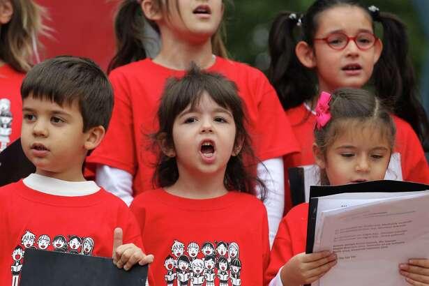 Nil Dursun, 4, (center) sings with the ATA Houston Children's Choir during the 26th Houston Turkish Festival at Jones Plaza Saturday, Nov. 17, 2018, in Houston.
