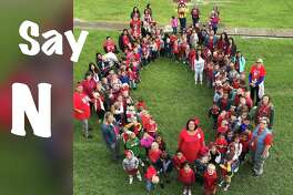 """Colbert Elementary Pre-K Students spell out an O for their """"Say NO to drugs"""" photo for the day."""