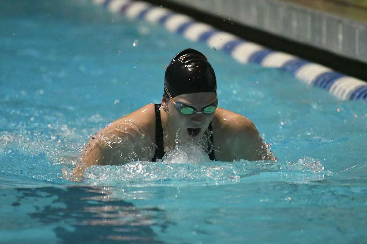 Makenna Nicholas of the Masuk Panthers swims the breaststroke leg of the 200 yd medley relay during the CIAC Open Swimming Championships on Saturday November 17, 2018, at Yale University in New Haven, Connecticut.